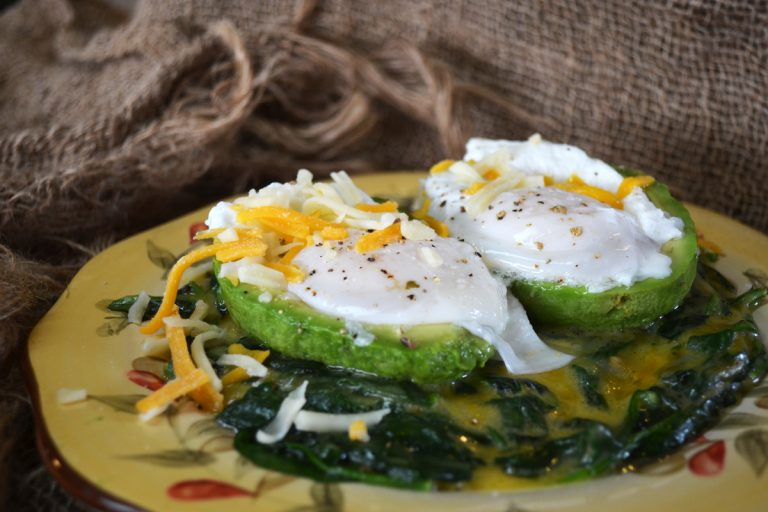 cheesey eggs florentine in avocado boats